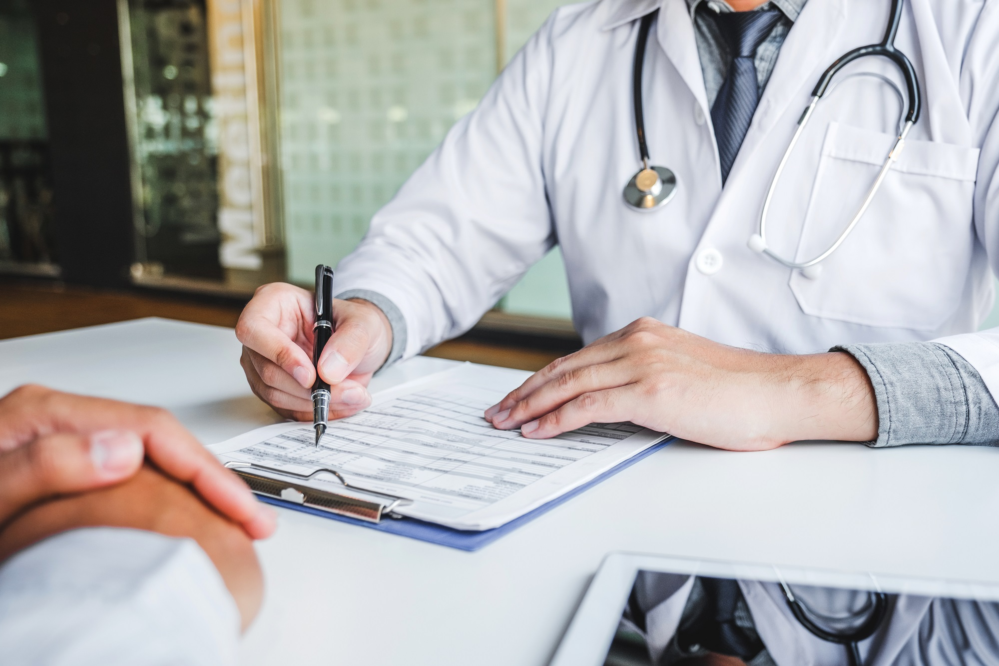Doctors and patients consulting and diagnostic examining sit and